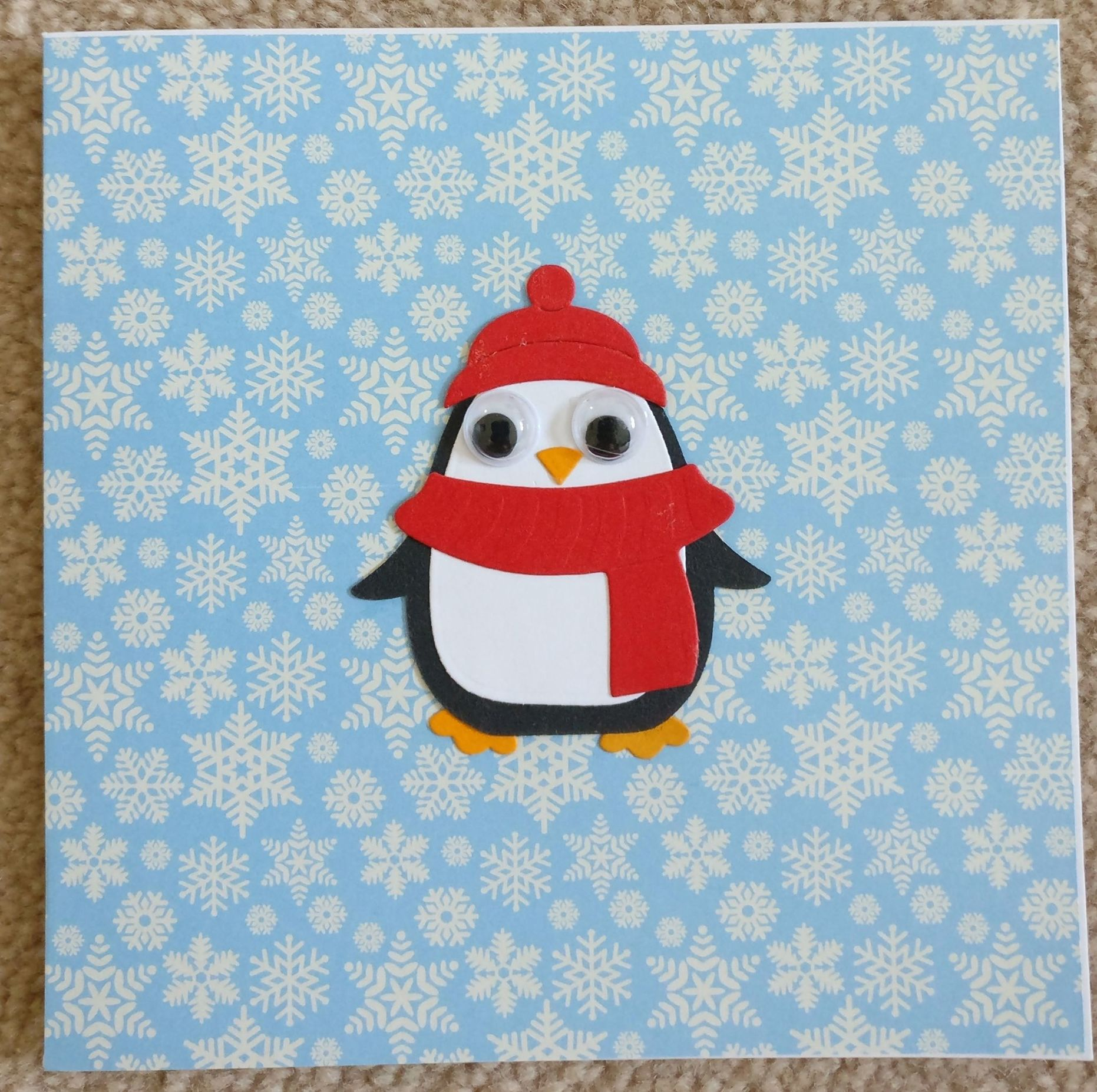 Christmas card penguin with personalised Braille message
