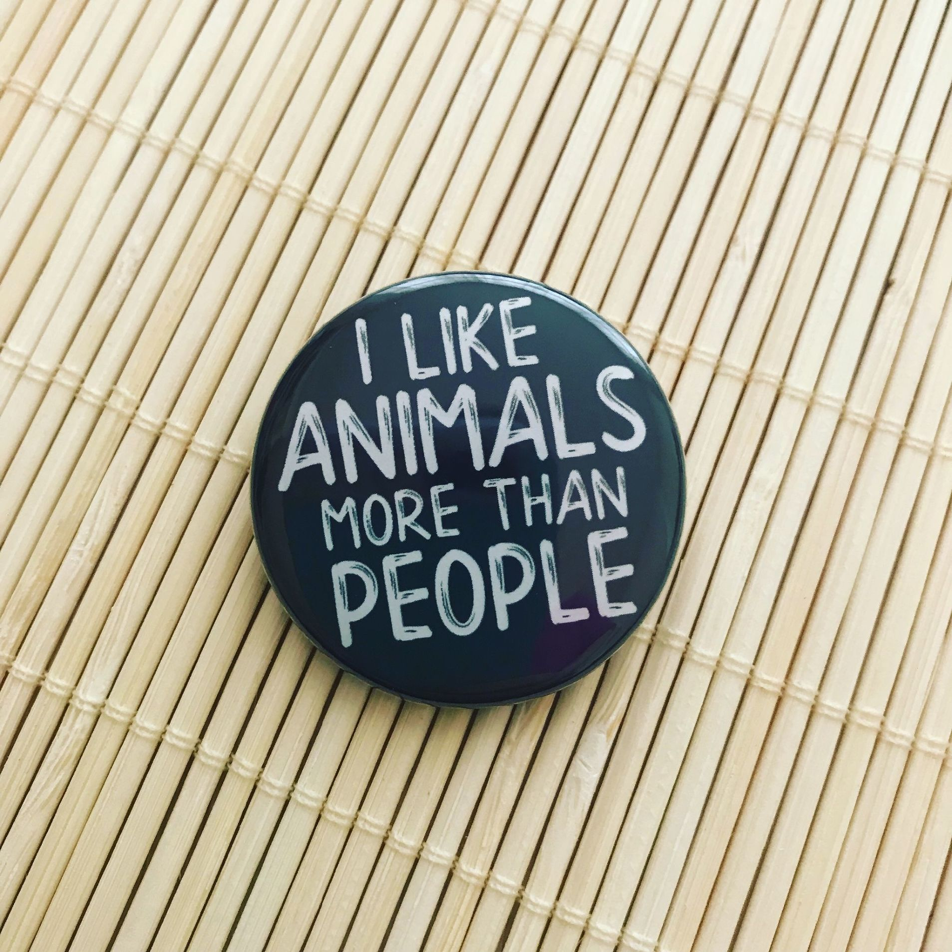 I like animals more than people round badge