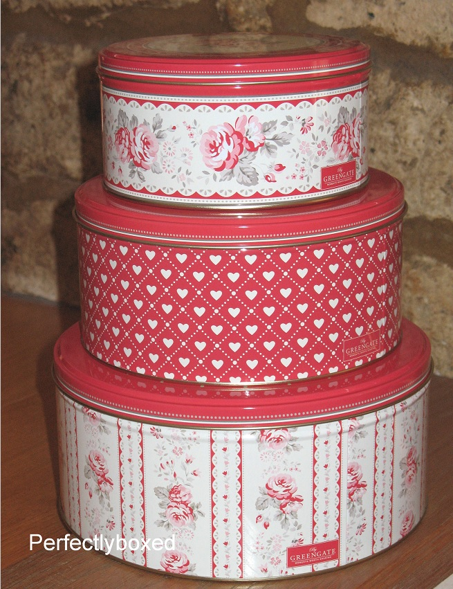 Red cake storage tins