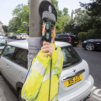Cardboard cop-out? Residents given FAKE policeman to stop speeding