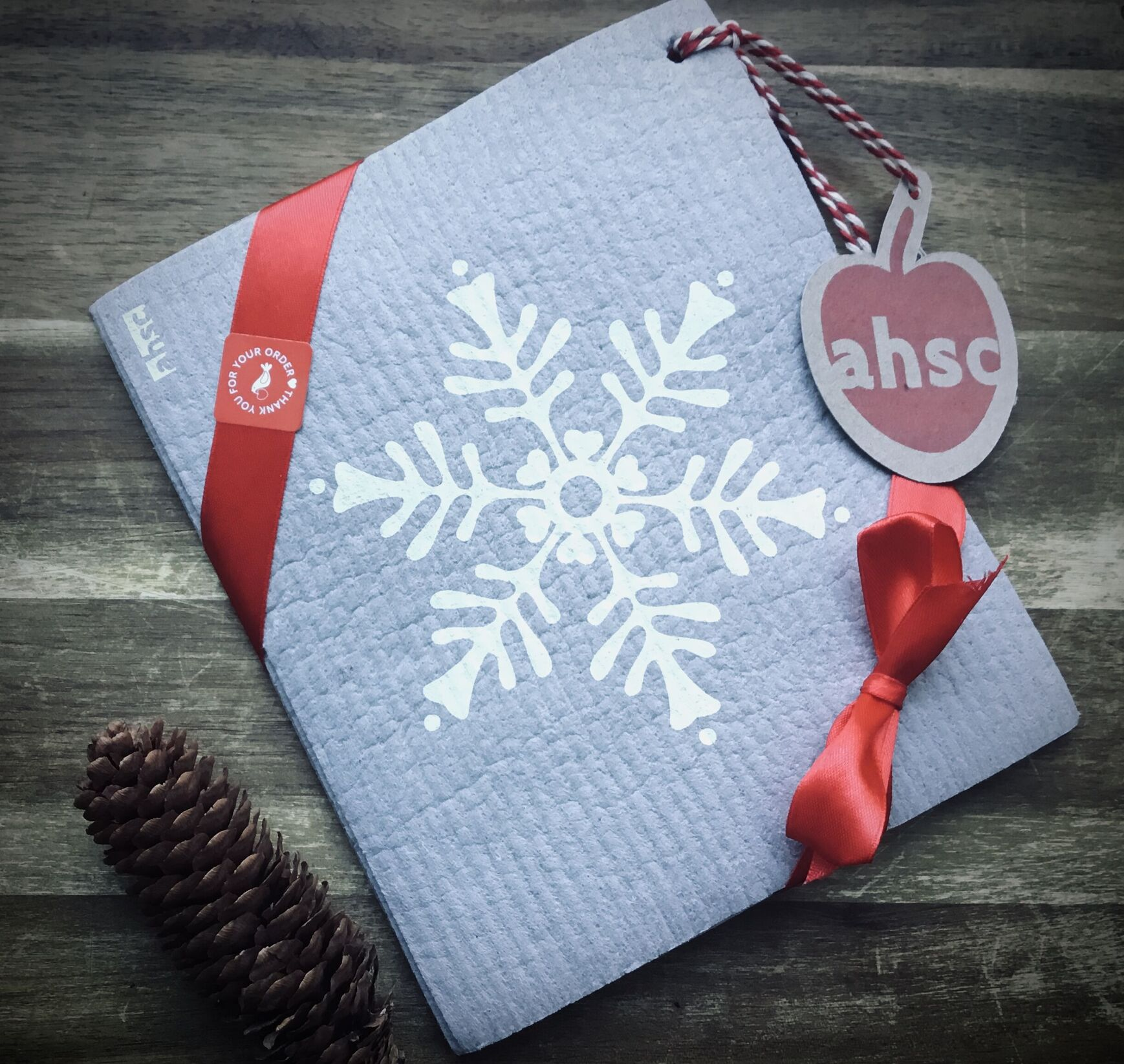 Snowflake Eco Dishcloth tied with ribbon