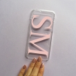 Clear and dusty pink monogram phone case with large initials