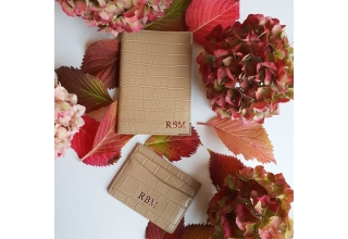 Nude embossed leather monogram passport holder
