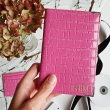 Pink embossed leather m..