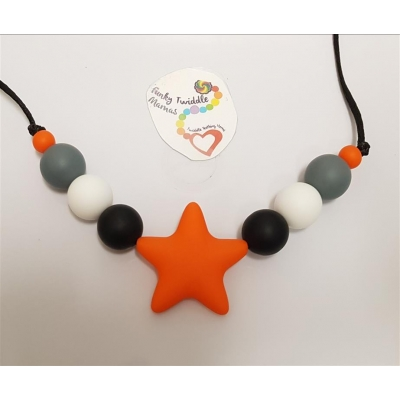 Monochrome silicone high sensory necklace with orange star 19mm beads