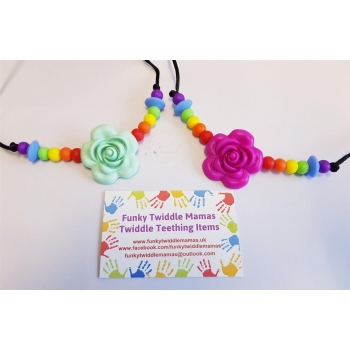 Rose with rainbow beadwork a..