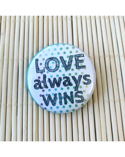 Love always wins. - round vegan friendly badge.