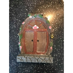 Latex mould for fairy door surrounded by flowers