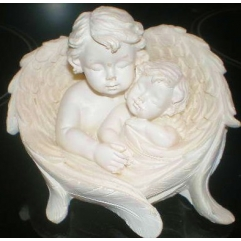 Cherub and baby in wings