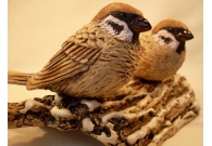 Sparrows on a snow covered log - Handm..